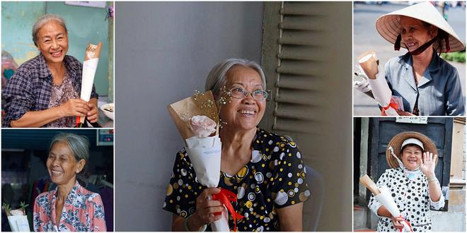 Nụ cười và giọt nước mắt của những người phụ nữ lam lũ trên đường phố Sài Gòn khi được tặng hoa 8/3 - Ảnh 1.