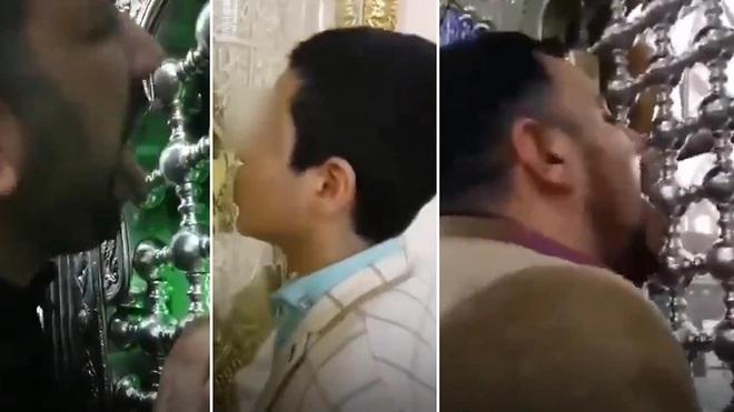 Video: Người dân Iran tập trung liếm đền thờ giữa lúc dịch bệnh virus corona bùng phát - Ảnh 1.