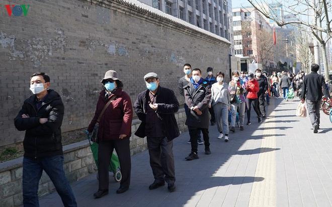 Các ca mắc mới Covid-19 có dấu hiệu tăng trở lại ở Trung Quốc - ảnh 1