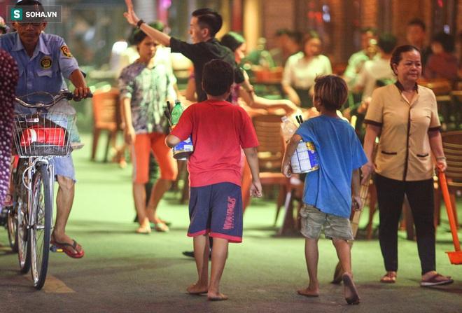 Những đứa trẻ không Tết thiếu nhi, trắng đêm phun lửa mưu sinh ở phố Tây Bùi Viện - ảnh 19