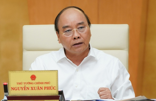 Thủ tướng: Covid-19 đã lây nhiễm ở 7 tỉnh thành, Hà Nội báo cáo ca bệnh - Ảnh 1.