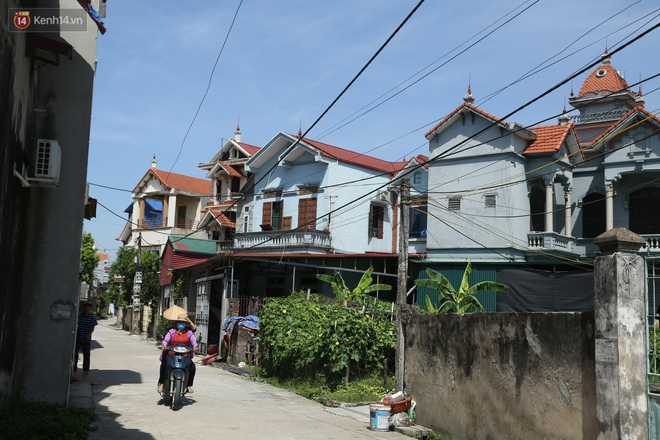 Hà Nội: Nhà tầng, biệt thự mọc san sát nhau ở ngôi làng phất lên từ việc buôn thịt lợn - Ảnh 7.