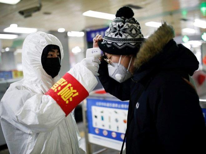 Trung Quốc nới lỏng quy định cách ly đối với người nhập cảnh - ảnh 1