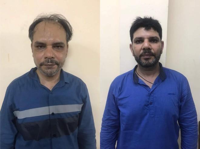 Bắt 2 người ngoại quốc thuê xe ô tô vờ đi mua hàng rồi cướp giật tài sản ở TP.HCM - Ảnh 1.