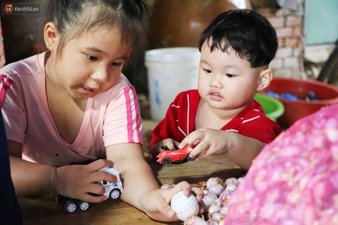 """Có một """"xóm cay mắt"""" của người miền Tây giữa lòng Sài Gòn: """"Tụi tui tính về quê mà không đủ tiền, Tết này ở đây thôi"""" - Ảnh 6."""