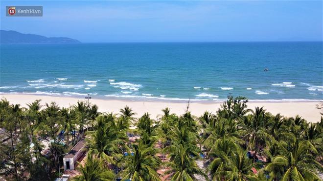 Ảnh: Bãi biển, khu vui chơi ở Đà Nẵng vắng bóng người trong ngày đầu siết chặt các biện pháp phòng, chống Covid-19 - ảnh 10