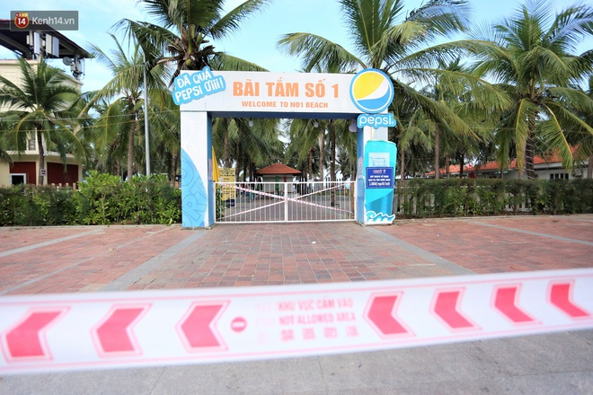 Ảnh: Bãi biển, khu vui chơi ở Đà Nẵng vắng bóng người trong ngày đầu siết chặt các biện pháp phòng, chống Covid-19 - ảnh 7