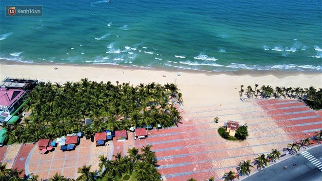 Ảnh: Bãi biển, khu vui chơi ở Đà Nẵng vắng bóng người trong ngày đầu siết chặt các biện pháp phòng, chống Covid-19 - ảnh 17