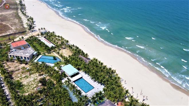 Ảnh: Bãi biển, khu vui chơi ở Đà Nẵng vắng bóng người trong ngày đầu siết chặt các biện pháp phòng, chống Covid-19 - ảnh 16
