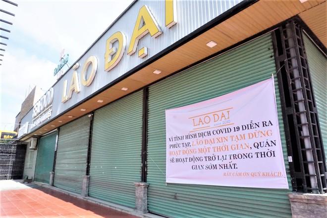 Chưa đến giờ G, nhiều hàng quán ở Đà Nẵng đã chủ động đóng cửa sớm để phòng dịch Covid-19 - ảnh 1