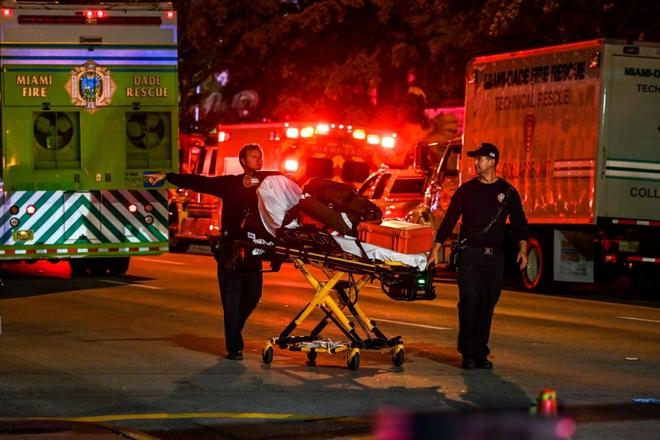 Hiện trường đổ nát vụ sập chung cư kinh hoàng ở Miami (Mỹ) - ảnh 12