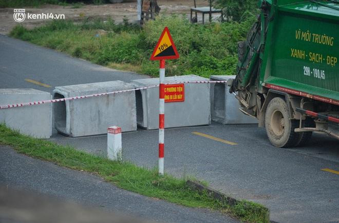 Điều xe tải, dùng gạch, thùng container làm chốt phong tỏa: Người dân vẫn dùng mọi cách để thông chốt - ảnh 7