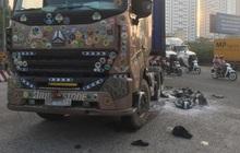 Xe máy cháy trơ khung sau va chạm với container, người đàn ông nguy kịch mắc kẹt dưới bánh xe ở Sài Gòn