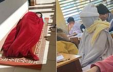 Học sinh đi học mùa rét: Tranh thủ nắng ấm mang chăn ra hành lang ngủ, bịt kín từ đầu đến chân như ninja