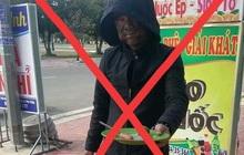 Thanh niên bôi đen mặt cầm đĩa lạp xưởng bị công an mời làm việc