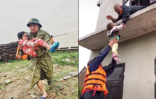 Khoảnh khắc chiến sĩ công an bế bé gái gãy tay vội vã lên ô tô tới bệnh viện trong cơn mưa lũ Quảng Bình gây xúc động
