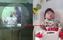 Em bé nhắm nghiền mắt trong sinh nhật đầu tiên tưởng như ngủ nhưng là kết quả của hành vi bạo hành bởi y tá gây chấn động Hàn Quốc 1 năm trước