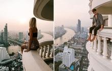 Travel blogger có 2,7 triệu followers đăng ảnh ngồi cheo leo trên lan can, tưởng gây ấn tượng nhưng kết quả nhận về cả rổ gạch đá