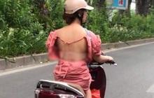 Cô gái mặc váy hớ hênh, lộ toàn bộ lưng trần phản cảm khi chạy xe máy khiến nhiều người đỏ mặt quay đi
