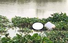 Phát hiện thi thể nữ giới buộc vào can nhựa trôi trên sông