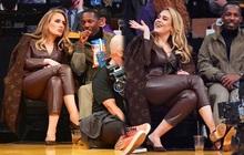 Adele lại gây sốt khi đi xem bóng rổ nhưng spotlight lần này chưa chắc rơi vào bộ cánh Louis Vuitton đâu nha!