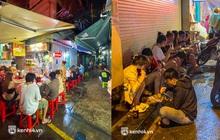 Nhiều bạn trẻ vô tư ngồi ăn uống ở chợ Hồ Thị Kỷ, bất chấp quy định hàng quán chưa được phép phục vụ tại chỗ