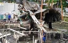 Ảnh: Công nhân dùng cần cẩu, nhấc xác máy bay B52 bị bắn rơi, nằm giữa lòng hồ ở Hà Nội sau gần 50 năm