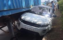 TP.HCM: Ô tô Range Rover bị xe container ép bẹp dúm, mắc kẹt dưới gầm