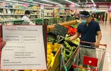Ảnh: Người dân TP.HCM xếp hàng, cầm phiếu đi siêu thị theo khung giờ