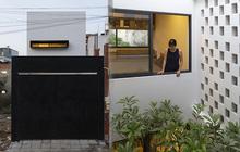 """Nhà phố """"hướng nội"""" với mặt tiền là 2 khối hộp, bên trong thiết kế hệ tủ 14m làm bếp kiêm nơi giặt đồ"""