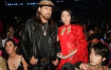 """Gia đình Miley Cyrus khoe sắc ở Grammy, nam idol Hàn vô tình """"ké ảnh"""" mà giật spotlight: Vòng 1 ngồn ngộn phải chào thua visual nam thần!"""