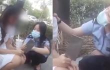"""Clip: Nữ cảnh sát """"thu phục"""" cô gái cầm dao phay bằng đúng một cốc trà sữa, dân mạng ca ngợi vì lối hành xử quá nhân văn"""
