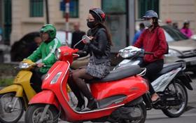 Chùm ảnh: Người Hà Nội khoác áo ấm, co ro trong đợt rét nhất từ đầu đông