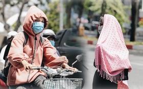 Chùm ảnh: Người Sài Gòn vật vã dưới nắng nóng như thiêu đốt