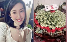 """Thuý Ngân diện giày đôi và khoe được tặng bó hoa toàn tiền đô kèm lời nhắn đặc biệt, đã """"chốt đơn"""" Trương Thế Vinh?"""