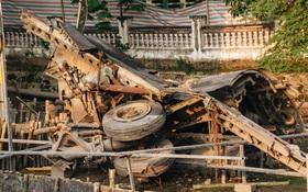 Clip, ảnh: Xác máy bay B52 ở Hà Nội gần 50 năm nổi lên sau khi rút nước hồ Hữu Tiệp