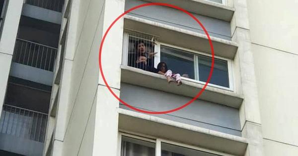 Bé gái ngồi cheo leo trên ban công tầng 6 chung cư Ecopark, liên tục gào khóc gọi mẹ