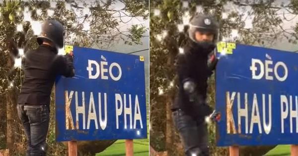 """Clip nam thanh niên """"đánh dấu"""" vào biển báo địa danh đèo Khau Phạ khiến dân mạng bức xúc: Đừng làm xấu danh nghĩa phượt thủ!"""