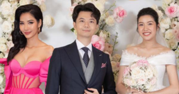 Hoàng Thuỳ gây tranh cãi khi mặc váy hồng chói chang dự đám cưới, cô dâu Thuý Vân phản ứng ra sao?