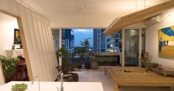 Căn hộ Quận 2 Sài Gòn làm vách nghiêng độc đáo giữa nhà, dù ở tầng 14 nhưng rộng thoáng không kém nhà mặt đất