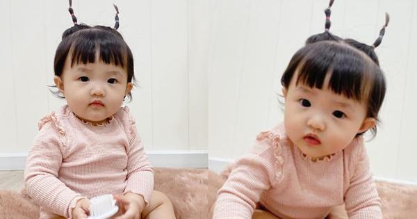 'Tiểu bánh bao' nhà Đông Nhi để tóc 2 sừng nhìn y chang chú dế mèn phiên bản 'cute', bảo sao bố mẹ mê làm dáng cho con suốt