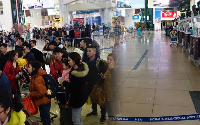 Ảnh: Sân bay Nội Bài vắng vẻ cận Tết Nguyên Đán, khác hẳn cảnh tượng đông đúc mọi năm