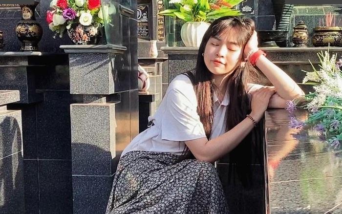 Khánh Vân gây tranh cãi với loạt ảnh tạo dáng ở bia mộ của người thân