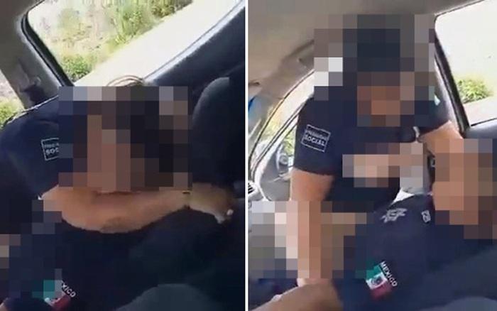 Hai sĩ quan cảnh sát còng tay nhau rồi